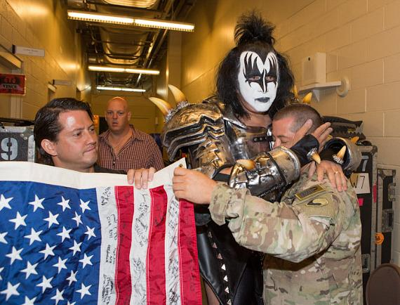 Gene Simmons hugs military member backstage befire KISS goes onstage at Mandalay Bay.