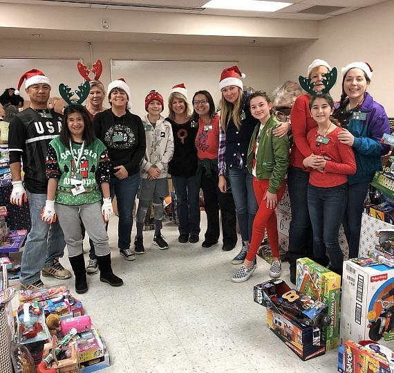 Volunteers at Catholic Charities Annual Christmas Toy Giveaway 2018
