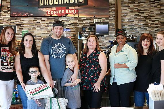 Gavin, Brendan and their family, along with Candlelighters Executive Director Melissa Cipriano at Krispy Kreme in Las Vegas