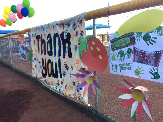 Children's art thanking partners Brendan Mann Foundation, Green Our Planet and Garden Farms adorn the garden's surrounding fence