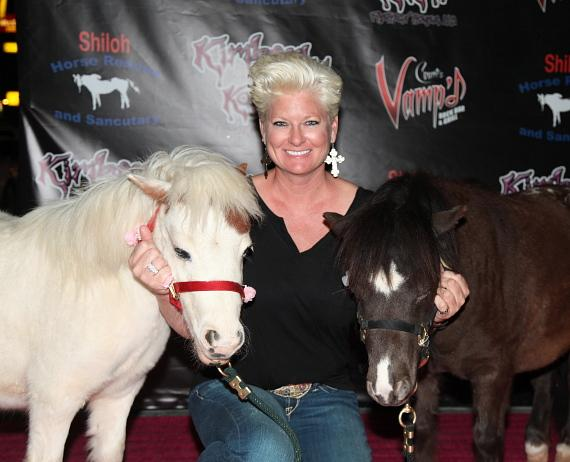 Jill Curtis with the charity's mini-horse ambassadors