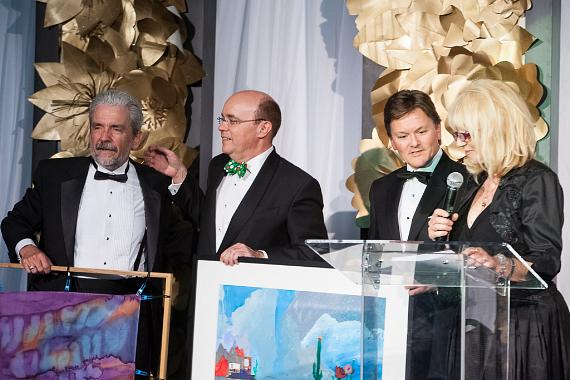 Barrick Gold Corporation Senior Executive Vice President, Kelvin Dushnisky along with Michael Brown are honored by Opportunity Village Executive Director, Edward Guthrie and Chief Development Officer Foundation Associate Executive Director, Linda Smith at the Magical Forest on Thursday, November 7