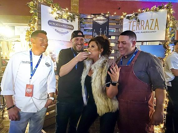 Emily Simpson poses for a photo with Mercato Della Pescheria's Executive Chef Nelson Berrios, Cafe Americano and The Terraza by Cafe Americano's Executive Chef Harold Norris, and V&E Restaurant Group's Executive Chef Matt Fresinski