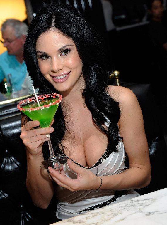Jayde Nicole sipping a signature Blowpop Martini at Sugar Factory American Brasserie