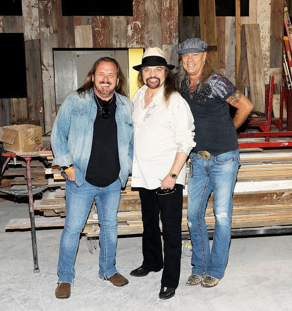 Johnny Van Zant, Gary Rossington and Rickey Medlocke pose for picture in new Las Vegas restaurant, Lynyrd Skynyrd BBQ & Beer at Excalibur Hotel & Casino