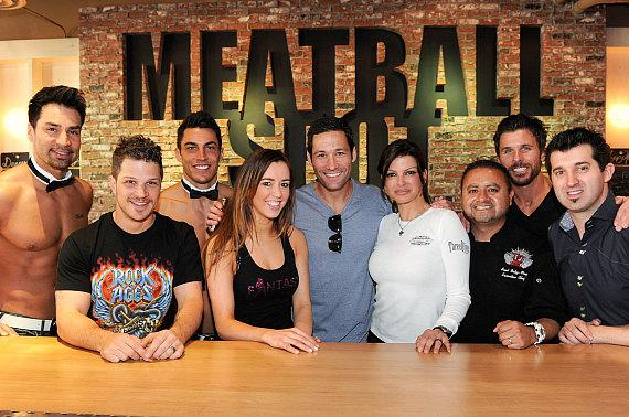 Carla Pellegrino with winner, Jon Howes, after meatball eating contest victory at Meatball Spot