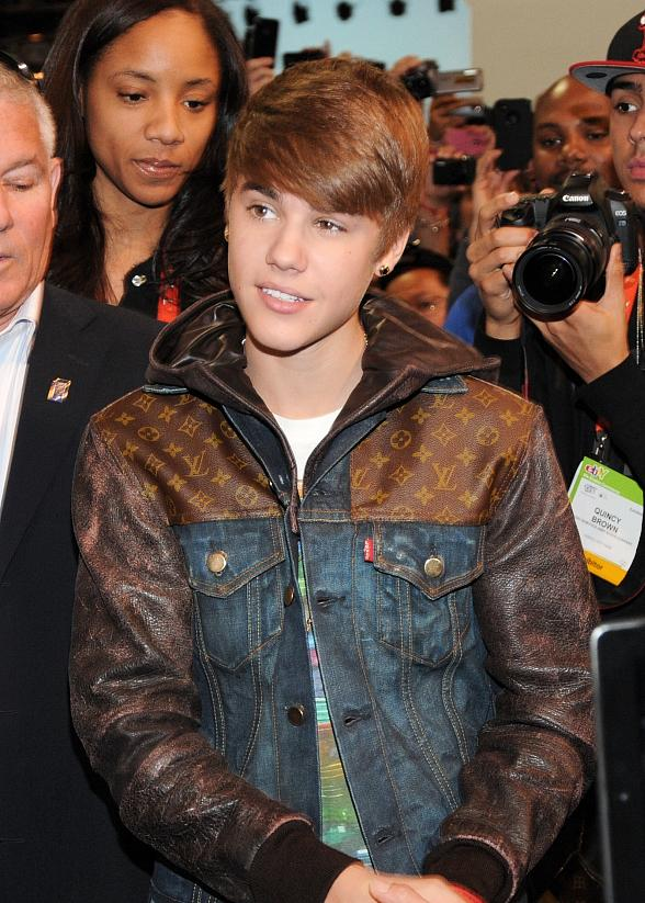 Justin Bieber at unveils dancing robot at TOSY booth at CES in Las Vegas