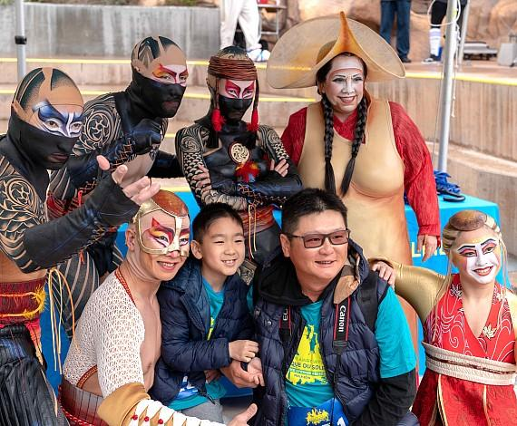 """KA performers pose with """"Run Away with Cirque du Soleil"""" participants"""