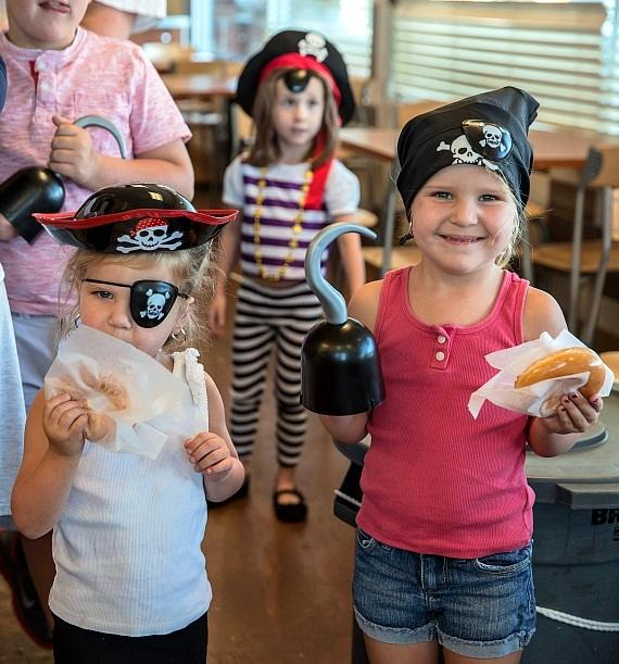 Children enjoying a Krispy Kreme doughnut for 'Talk Like a Pirate Day'