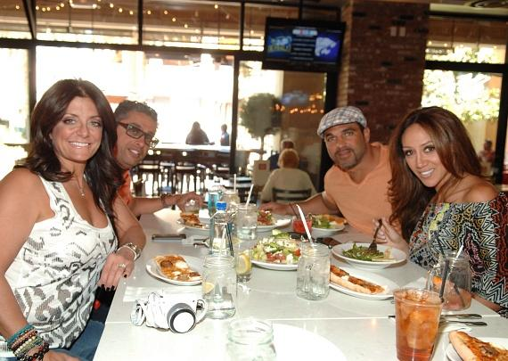 Kathy and Richard Wakile and Joe and Melissa Gorga sharing plates at Meatball Spot