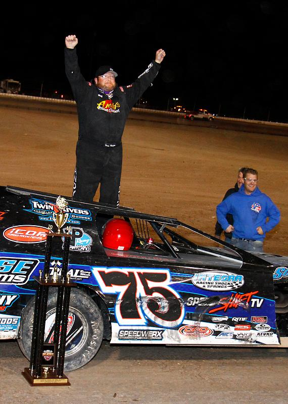 Duel in the Desert winner Terry Phillips of Springfield, Mo., celebrates his victory at The Dirt Track at Las Vegas Motor Speedway.