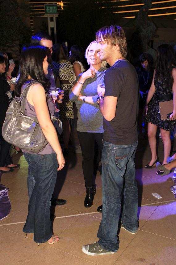 Larry Birkhead chatting with friends
