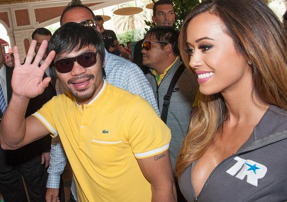 Manny Pacquiao waves to fans as he arrives at The Venetian Las Vegas