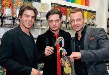 Matthew, Andrew and Joey Lawrence (L to R) pick out sweets at Sugar Factory's oversized candy bin wall
