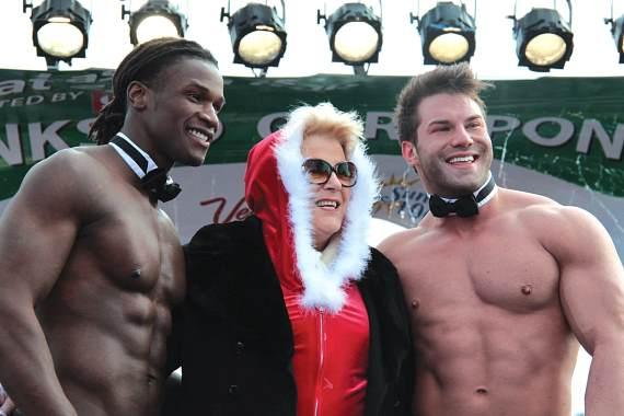 Mayor Carolyn Goodman with Rio's Chippendales at GSR 2012 at Town Square Las Vegas