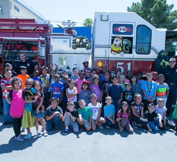 Members of the James Clubhouse Boys & Girls Clubs of Las Vegas with the North Las Vegas Fire Department and Sparky The Fire Dog