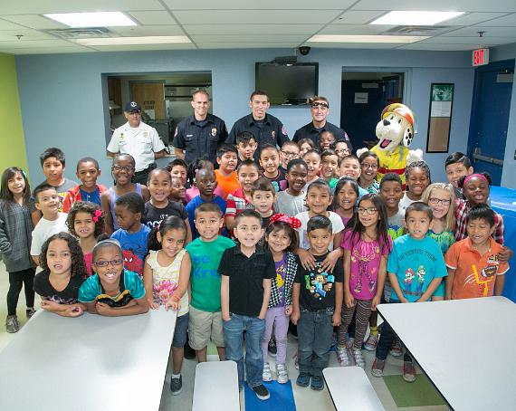 Members of the North Las Vegas Fire Department and sparky The Fire Dog of the National Fire Protection Association pose with members of the James Clubhouse of Boys & Girls Club of Las Vegas