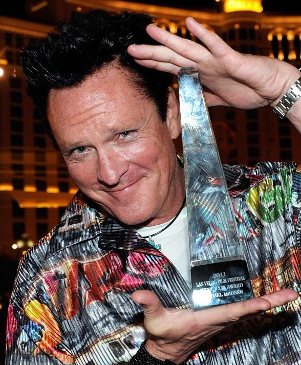 Michael Madsen poses with his Indie Icon Award at Chateau Nightclub & Gardens at Paris Las Vegas