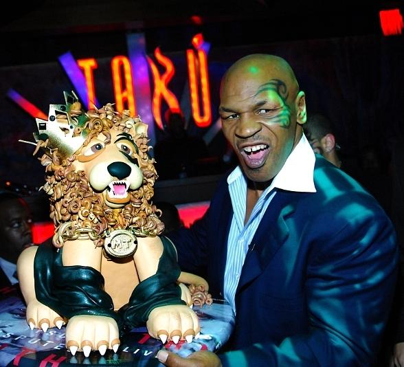 Mike Tyson Growling with Lion Cake at Tabú Ultra Lounge