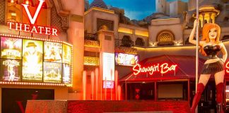 Miracle Mile Shops' Fountain Glows Red in June for Golden Rainbow