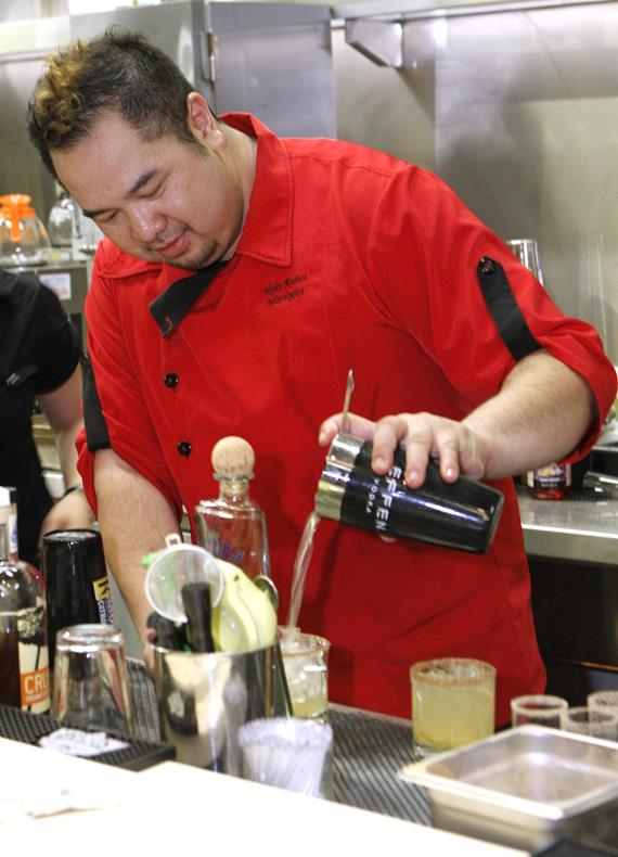 Mixologist pouring drinks
