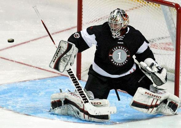Wranglers goaltender Mitch O'Keefe blocks a shot from the Utah Grizzlies