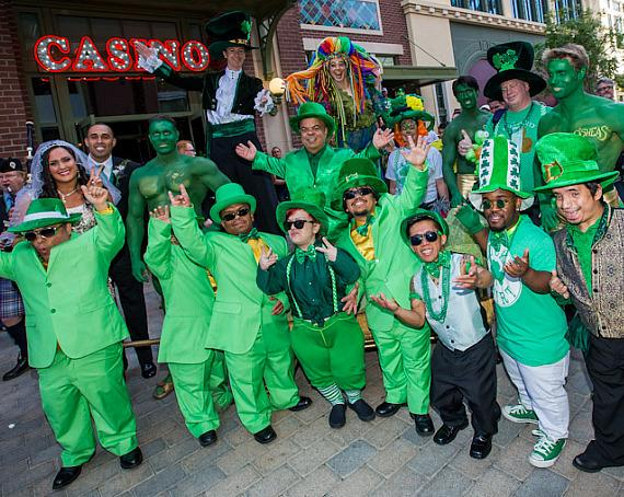 "Gathered at the entrance of O'Sheas Casino, Brian ""Lucky"" Thomas, Joe Greene and Jennifer Michaelson, a troop of leprechauns, stilt walkers, balloon artists, green hunks and bag pipers, kicked-off O'Sheas St. Patty's Day Block Party"