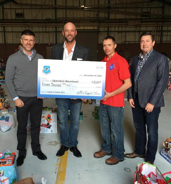 Nellis Support Team Presents Operation Warmheart with $15,000 for Needy Military Families