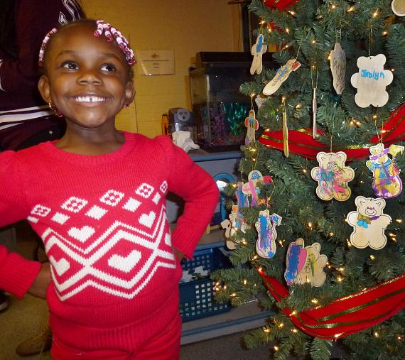 Children with hand-made ornaments on a Christmas tree at the BOBS from Skechers event at  Variety Early Learning Center