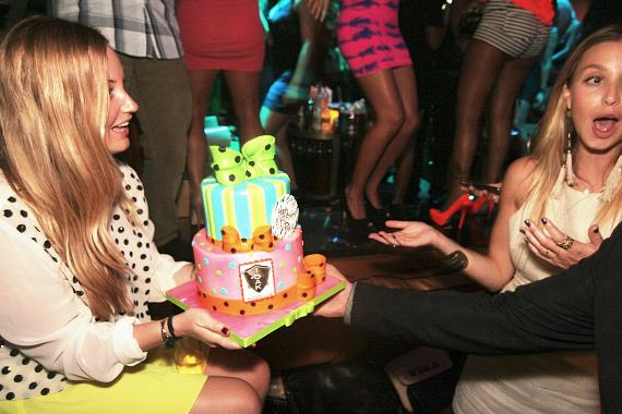 Paige and Whitney Port with birthday cake at 1 OAK Nightclub