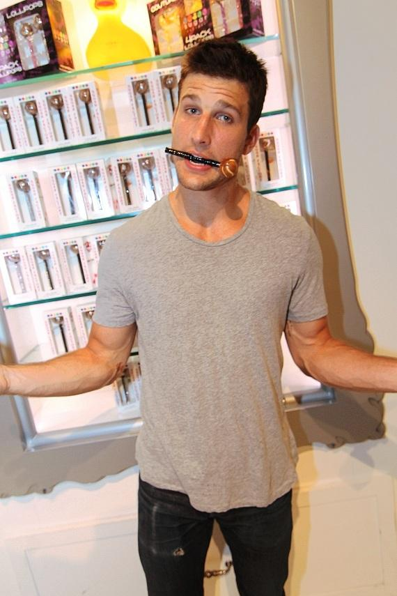 Parker Young signing Sugar Factory merchandise for fans inside the retail store