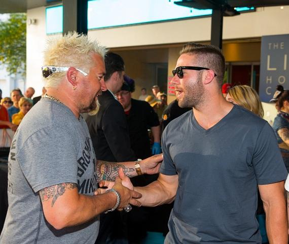 Guy Fieri poses with New England Patriots player Julian Edelman at Guy Fieri's Vegas Kitchen & Bar