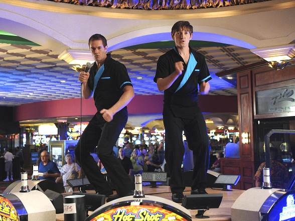 In an attempt to raise money for a wedding, Lucas Neff (right) and Garret Dillahunt (left) pretend to work as beverage-serving entertainers at the Rio All-Suite Hotel & Casino in Las Vegas in the