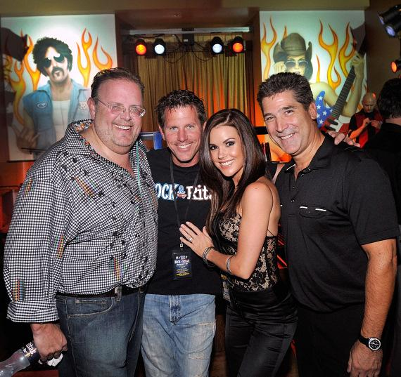 """Owners David Tuttleman and Mark Green pictured with iconic rockers """"Rock"""" and """"Rita."""""""
