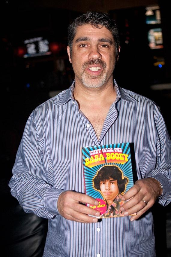 """Gary Dell'Abate with his book """"They Call Me Baba Booey"""" at Rick's Cabaret Vegas"""