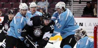 Smith (19) takes a shot against the Alaska Aces in the 2011 Kelly Cup Finals