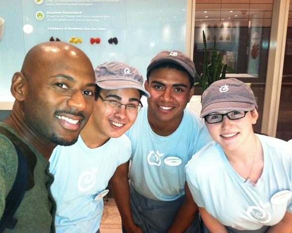 Actor Romany Malco with staff of Pinkberry