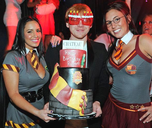 """Rupert Grint with VIP cocktail waitresses dressed in """"Harry Potter"""" costumes at Chateau Nightclub & Gardens"""