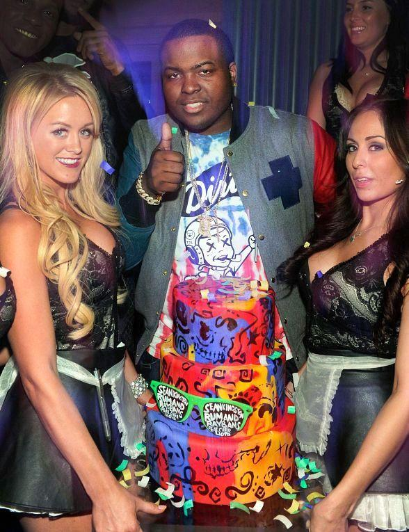 Sean Kingston with servers and birthday cake at Chateau Nightclub & Gardens
