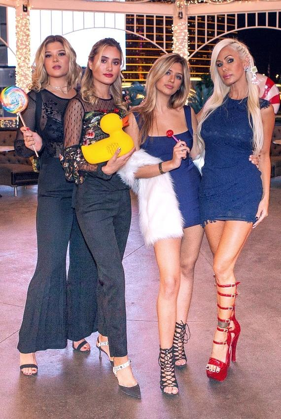 Shauna Sand and daughters enjoy Sugar Factory's candyland gazebo
