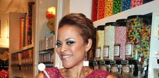 Shaunie O'Neil poses with the Sugar Factory Couture Pop inside the Sugar Factory retail store