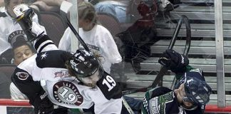 Wranglers left wing Robbie Smith lays Everblades center Trevor Bruess out in Las Vegas' 2-1 victory
