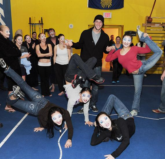 Tim Tebow with Contortionists at