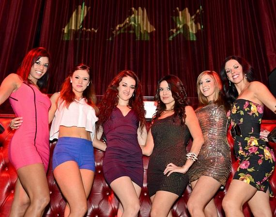 The FANTASY ladies in front of the DJ booth at LAX Nightclub