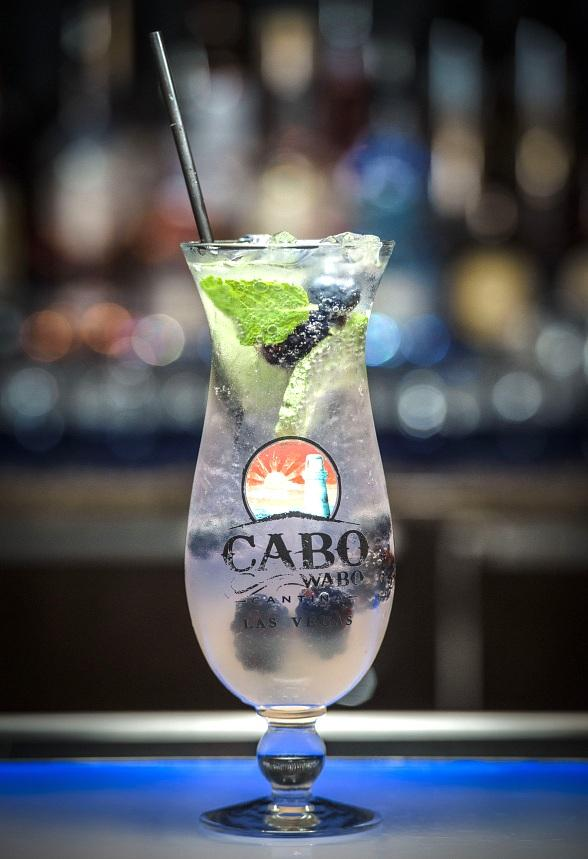 """Cabo Wabo Cantina, located inside Miracle Mile Shops at Planet Hollywood Resort & Casino, will honor National Breast Cancer Awareness Month by donating a portion of the proceeds from each Vojito cocktail purchase to Susan G. Komen of Southern Nevada throughout the month of October. Cabo Wabo's original Vojito is handcrafted with Devotion Black and Blue vodka, fresh berries, fresh mint and lime juice, priced at $13. Guests also have the option of keeping the souvenir Vojito glass for an additional $10. From Sunday, Oct. 1, through Tuesday, Oct. 31, Cabo Wabo will donate $1 from each sale to Susan G. Komen of Southern Nevada, a nonprofit organization dedicated to raising funds to provide breast health education, screening and treatment services to medically underserved women in the area. Guests who purchase the Vojito during October will also receive a complimentary pink rubber wristband. About Cabo Wabo Cantina: Awarded """"Best Tequila Selection"""" in the 2015 Best of Las Vegas awards, Sammy Hagar's hard rockin' dining and live music venue combines the laid-back beach-town vibe of Cabo San Lucas, Mexico, with the excitement of the Las Vegas Strip. Blending coastal Mexican and Tex Mex cuisine, the menu offers a tantalizing mix of flavorful food, killer margaritas and an awesome venue where it is never uncommon to catch the Red Rocker himself jamming out with a live set on stage. Cabo Wabo Cantina opens daily at 8 a.m. More information about Cabo Wabo Cantina is available at www.cabowabocantina.com, by calling 702.385.2226, by following Cabo Wabo on Twitter and liking Cabo Wabo on Facebook. For more information about Hagar and his famous Cabo Wabo Tequila, guests may visit www.redrocker.com and www.cabowabo.com."""