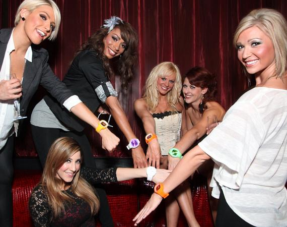 The ladies showing off their new watches gifted from a fan