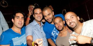 Tony Parker (center) dines with friends at LAVO