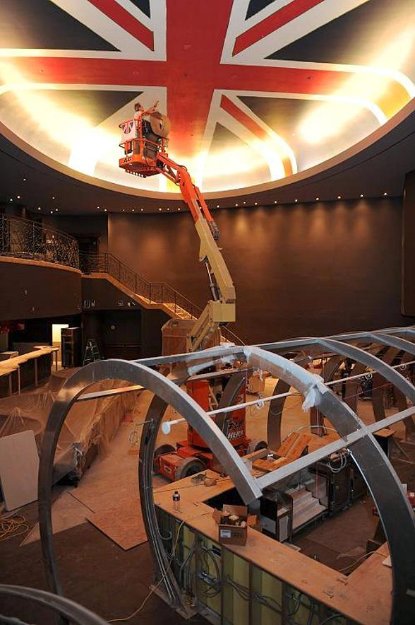 Painters high above the dining room at Gordon Ramsay Steak working on the ceiling