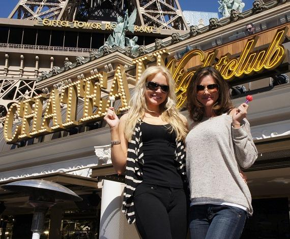 Playmates Alison Waite and Stacy Fuson dancing with Sugar Factory Couture Pops at the Chateau Beer Garden at Paris Las Vegas