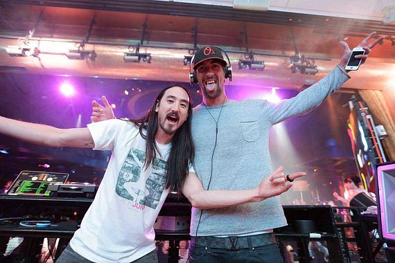 Michael Phelps and Steve Aoki jump at XS